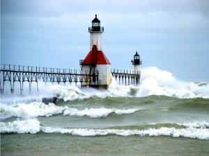 The hurricane Sandy arriving to the lighthouse on the North pier in Saint Joseph (Michigan)