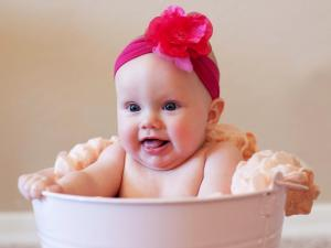 Baby seated in a dishpan