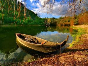 Little boat on the riverside