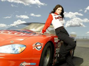 Girl posing over a race car