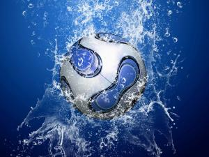 Soccer ball falling into the water