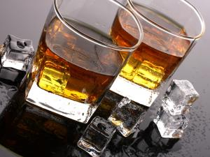 Two glasses of whiskey and ice cubes