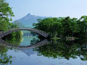 Oriental bridge crossing a calm river