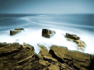 Haze on a rocky breakwater