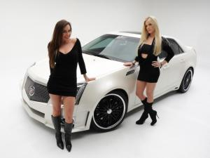 Girls next to a white sports car