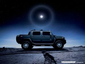 Hummer vehicle on a starry night