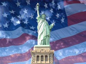 The Statue of Liberty with American flag background