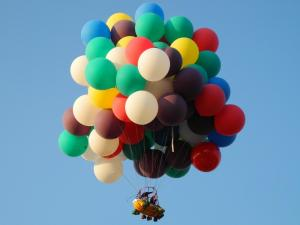 Flying with many colorful balloons
