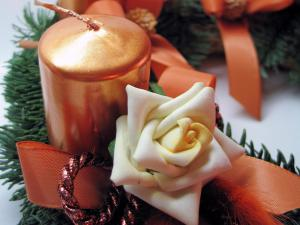 Rose and candle in a Christmas decoration