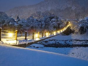 Illuminated bridge snow covered