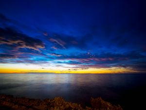 Blue and yellow sky over the sea