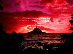 An island under a red sky