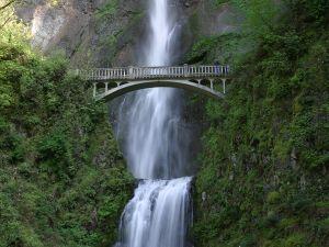 Bridge beside a waterfall