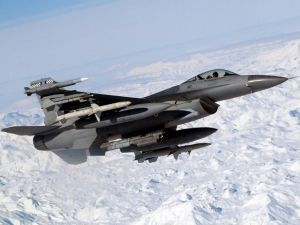 An F-16 Fighting Falcon flying over a frozen zone