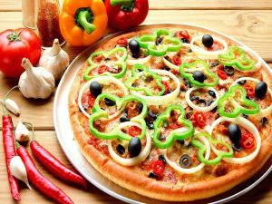 Pizza with onions, peppers and olives