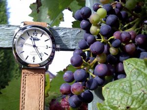 Grapes and a clock