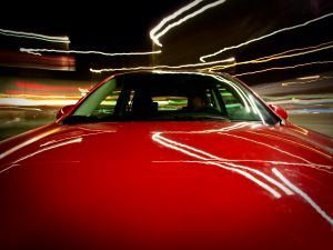 Speed in a red Mazda