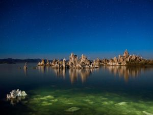 Rock formations in the middle of a lake, at night