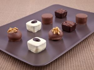 White and black chocolate bonbons with nuts