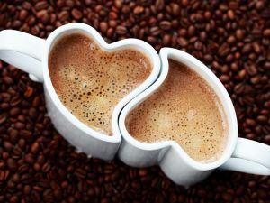 Cups of coffee with heart shape