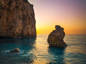Sunset on a beach in Milos (Greece)