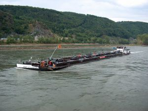 Fluvial traffic in hopper barge by the river Rhine
