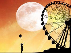 Girl at the fair, on a full moon night