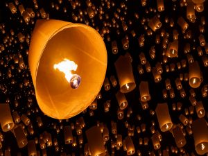 Flying fire lanterns at night