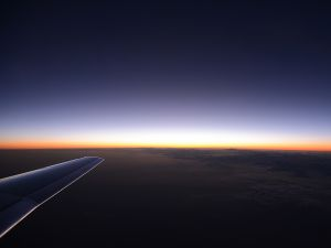 The wing of the plane below the horizon