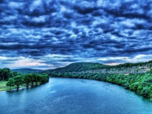 Cloudy sky over a river
