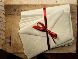 Envelopes tied with a red ribbon