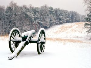 An old cannon covered in snow