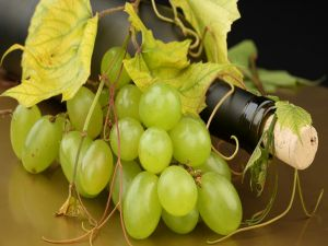White grapes and a bottle of wine