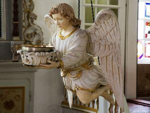 Sculpture of an angel holding a basin
