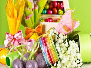 Easter eggs with ribbons and flowers