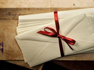Letters tied with a red ribbon