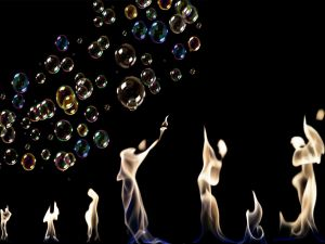 Silhouettes on fire and soap bubbles of different colors