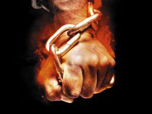 Hand grabbing a chain