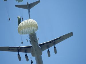 Jumping in parachute from a C-141 Starlifter aircraft