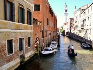 Strolling gondola through the canals of Venice