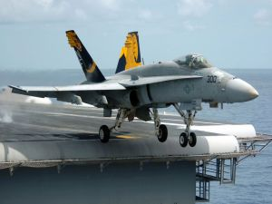An F/A-18 Hornet taking off from an aircraft carrier