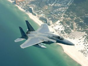 Fighter jet overflying a beach
