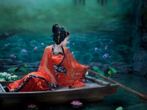 Oriental woman sailing between lotus flowers