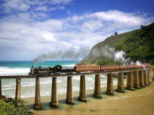 Steam train crossing the beach