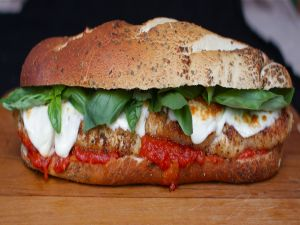 Cereal bread with basil, mozzarella and tomato
