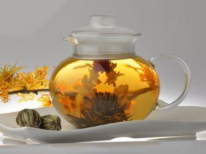 Teapot with tea flowers