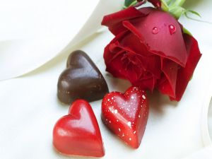 Chocolate hearts and a rose