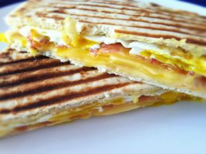 Toasted sandwich with ham, cheese and egg