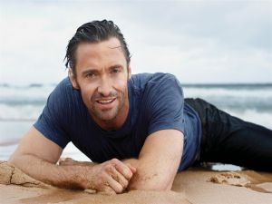 Hugh Jackman lying on the beach