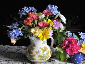 Vase with variety of colorful flowers